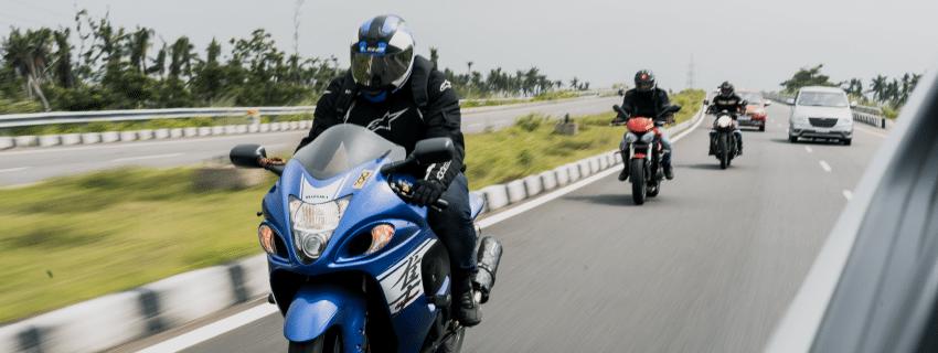 View of multiple bikers on highway