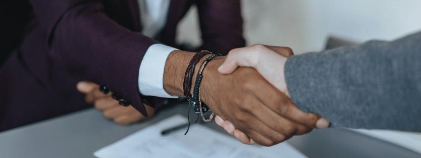 Attorney and rider handshake